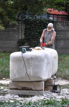 Pryluky, Ukraine - 09142018: Sculpture Symposium, creation of the monuments. Sculptors creating sculptures. For your design