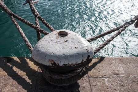 mooring bollard on the dock with ropes on it Reklamní fotografie