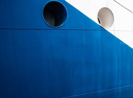 board of the ship with portholes painted in white and blue Reklamní fotografie