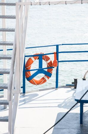 deck of the ship with white stairs and orange lifebuoy on the fence Reklamní fotografie