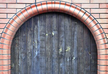 brick arch with wooden doors