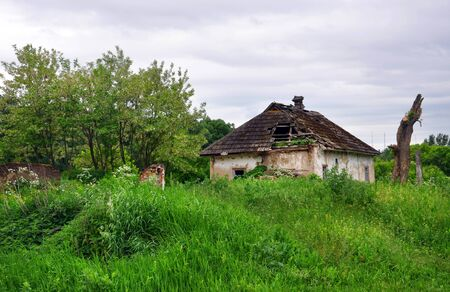 rural landscape with an old ruined house for your design