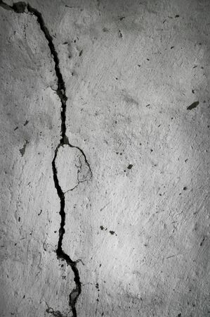 old plastered wall with a crack in it Banco de Imagens