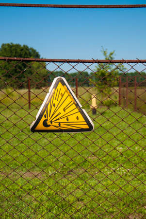 Explosion danger sign hanging on the fence around the gas installation