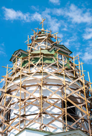 Restoration of the Orthodox Church. Wooden scaffolding. Quality image for your project Banco de Imagens