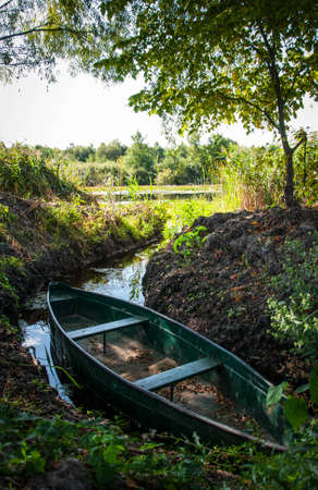 Wooden boat moored in the bay of the river among the reeds. Quality image for your project 版權商用圖片