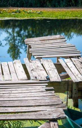Small wooden pier near the river. Quality image for your project