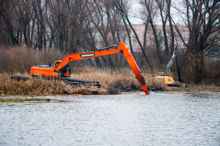 Pryluky, Chernihiv, Ukraine - 11/19/2020: Amphibious Excavators. River Cleaning. Quality image for your project
