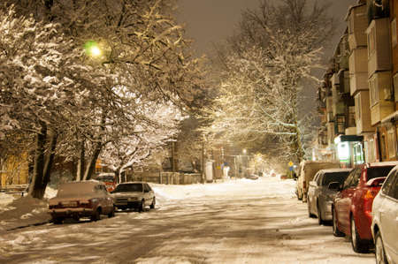 Pryluky, Chernihiv, Ukraine - 02/15/2021: Snow-covered evening streets of a small Eastern European town. Local cityscapes