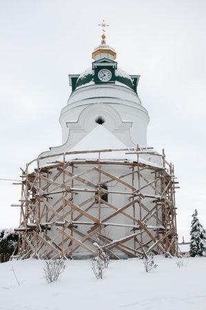 Pryluky, Chernihiv, Ukraine - 02/15/2021: Restoration of the Orthodox Church. Wooden scaffolding