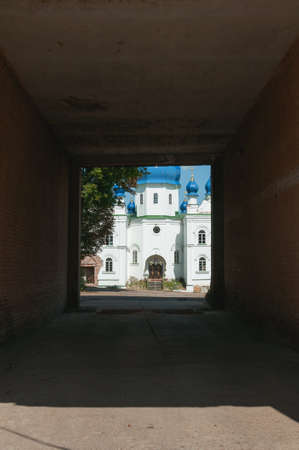 Ladan, Chernihiv, Ukraine - 08/14/2021: Building of the Orthodox Church at the end of a dark tunnel. The concept of hope Stock Photo