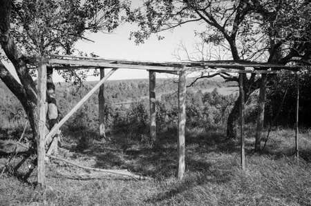 Black and white photo of a wooden canopy for hay. Atmospheric photography. Quality image for your project