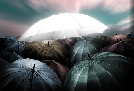 umbrella lights glowing standing out from crowd of dark umbrella, Business, leadership concept, being different concepts.