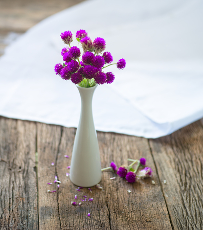 Composition of small, delicate flowers, beautifully laid out on the table and put in a jar