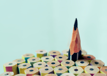 One sharpened pencil standing out from the other new pencil. Stock Photo