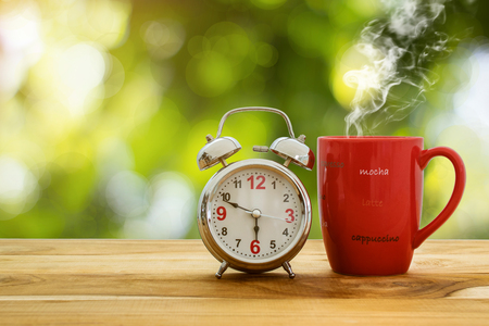 Good morning coffee and alarm clock concept. Stock Photo