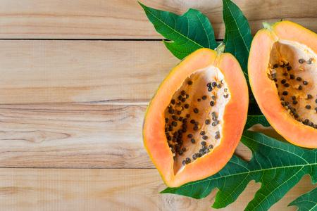 ripe papaya on wood table from above , ripe papaya health benefits. Stock Photo