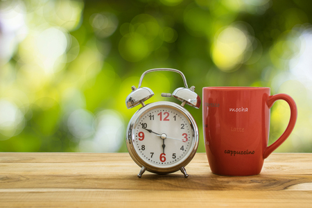 decaf: Good morning coffee and alarm clock concept. Stock Photo