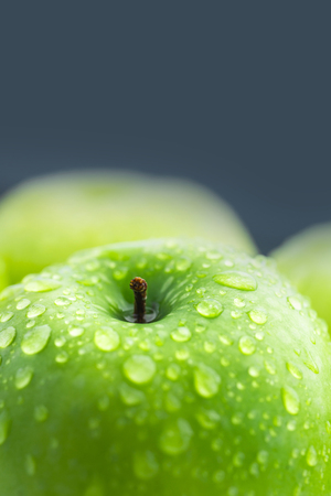 Green apples composition with water drop