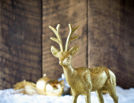 elves: christmas gold reindeer decoration with wood background