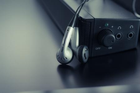 tercet: earpiece with speaker background