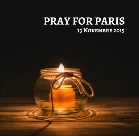 candles withe PRAY FOR PARIS text