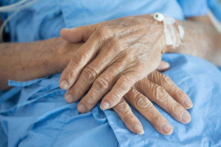 old man hand sleeping in a hospital Stock Photo