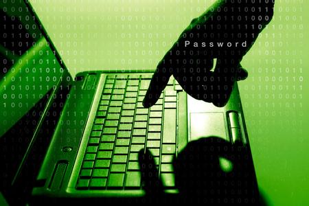 spy ware: Hacker using laptop