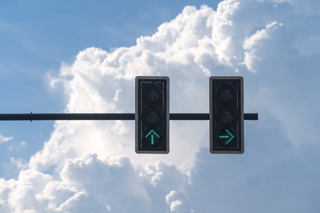 Green color on the traffic light with blue sky background.