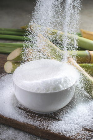Sugar being poured into a bowl diabetes concept Empty ready for your product display or montage.