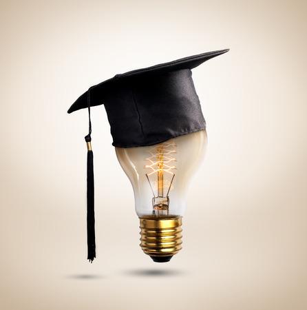 dweeb: congratulations graduates cap on a lamp bulb, concept of education.