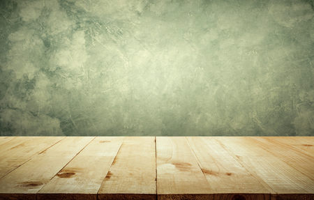 kitchen island: Wood table top with vintage grunge cement wall background copy space ready for your product design. Stock Photo