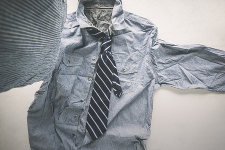 wrinkle striped shirt with necktie taking a selfie hipster man, untidy man concept.