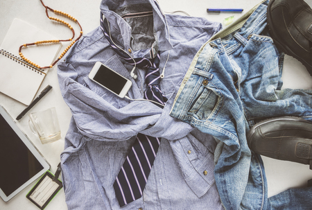 untidy: flat lay wrinkle striped shirt, Jeans, tablet, shoes and necktie, hipster man untidy man concept.