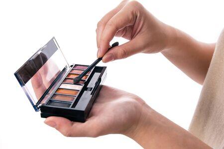 Women using cosmetic brush Stock Photo