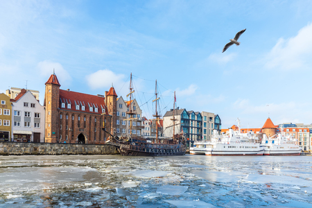 Winter Motlawa river in Gdansk, view on the Mariacka Gate and the ships.