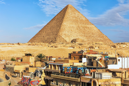 Giza town in front of the Pyramid of Cheops, Egypt.