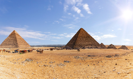 Giza Pyramids and the camp of bedouins and camels, Egypt. Stock Photo