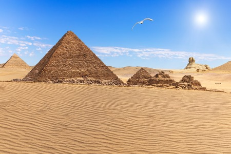 The Pyramid of Menkaure and the three pyramid companions in teh desert of Giza, Egypt Stock Photo