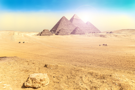 Egyptian desert scenery with the Great Pyramids of  Giza