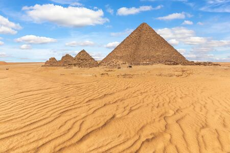 The Pyramid of Menkaure and the small pyramids in the beautiful desert of Giza, Egypt.