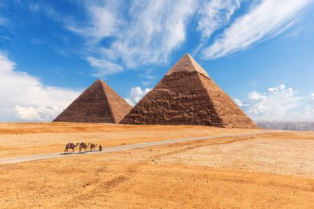 The Giza Pyramids in the desert, sunny day scenery. Stock Photo