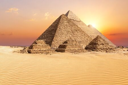 The famous Giza Pyramids in the desert at sunset, Egypt
