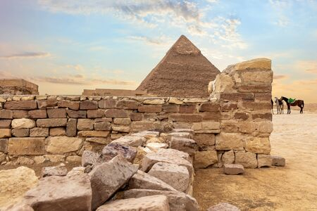 Temple ruins and the Pyramid of Khafre, Giza, Egypt. Imagens - 128769069