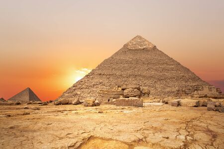 Sunset in the desert and the Pyramid of Khafre, Egypt.