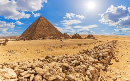 The Pyramid of Menkaure and the rocks in the desert of Giza, Egypt.