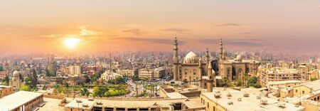 Mosque-Madrassa of Sultan Hassan in the sunset panorama of Cairo, Egypt.