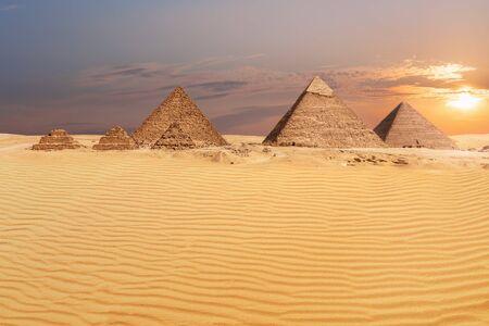 Sandy desert of Giza and beautiful pyramids view.