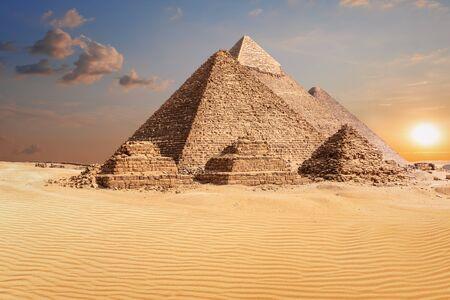 Famous Pyramids of Giza, beautiful sunset photo.