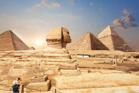 A tourist in Giza enjoying the Sphinx and the Pyramids, Egypt.